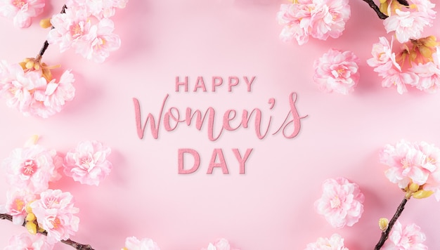 Happy women's day concept, pink plum blossom frame on pastel