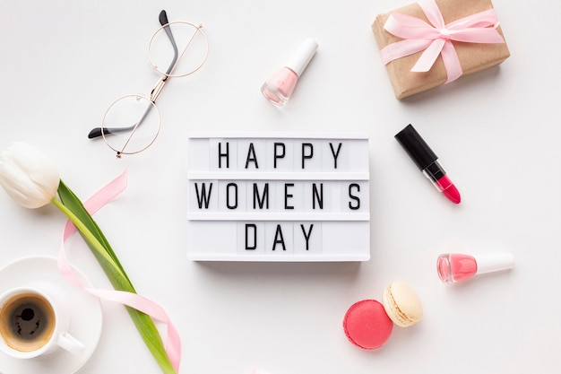 Happy women's day lettering on white background