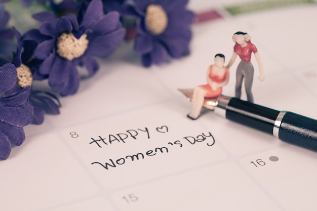 Happy women's day note on calendar book.
