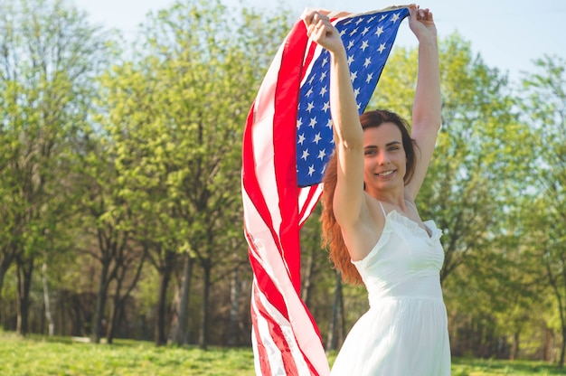 Happy women with american flag usa celebrate 4th of july