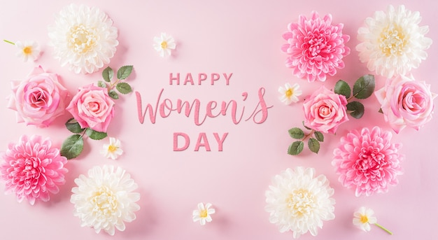Happy womens day concept pink roses and beautiful flower frame on pastel