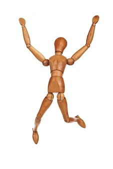 Happy wooden dummy in jump action isolated on white