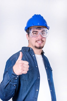 Happy worker with thumb up isolated
