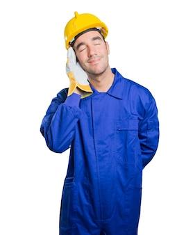Happy workman sleeping on white background