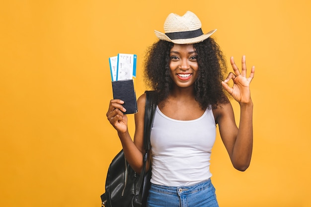 Happy young african american black woman with air tickets