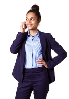 Happy young african businesswoman talking on mobile phone