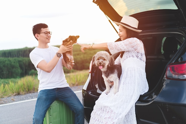 Happy and young asian couple enjoying life travel lifestyle with pets.