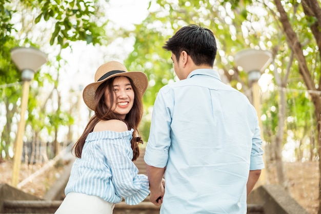 Happy young asian couple in love having a good time