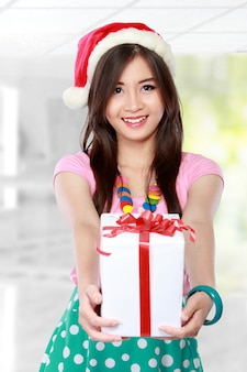 Happy young asian woman bring gift boxes
