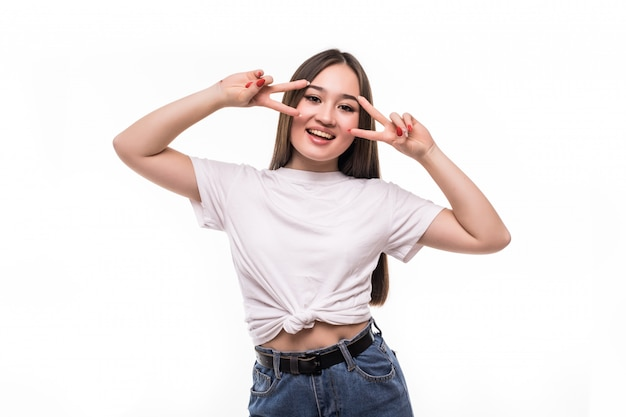 Happy young asian woman showing two fingers