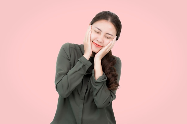 Happy young asian woman shying and touch her cheek.