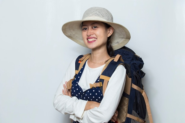 Happy young asian woman tourist on white background