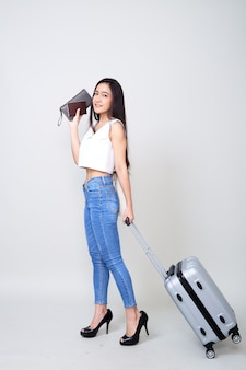 Happy young asian woman travel