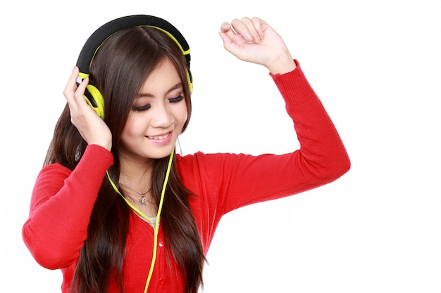 Happy young asian woman with headphones