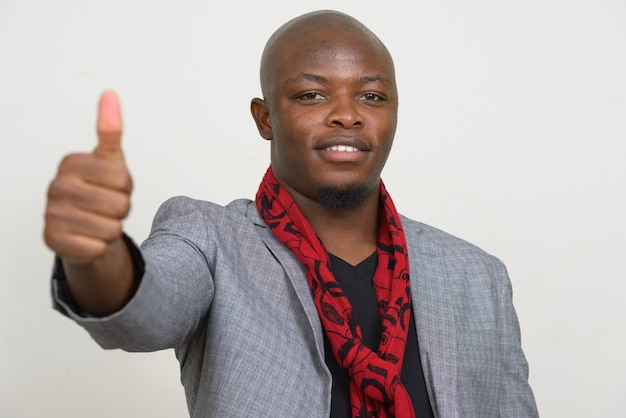 Happy young bald african businessman giving thumbs up
