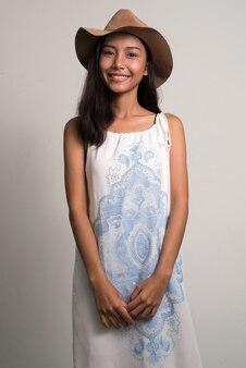 Happy young beautiful asian teenage girl as tourist smiling
