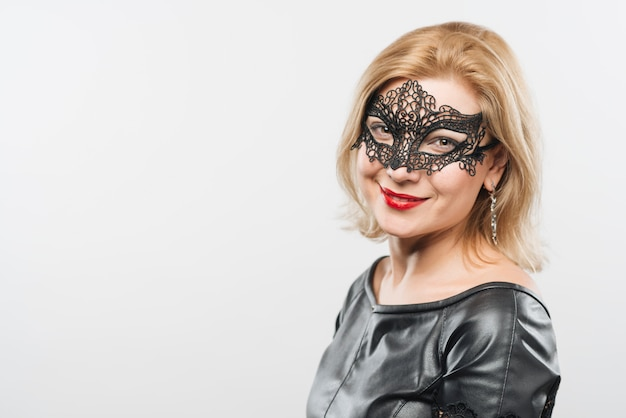 Happy young blond lady in mask