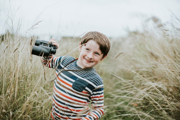 Happy young boy with a pair of binoculars