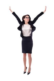 幸せな若いビジネス女性の白い背景で隔離のジャンプ