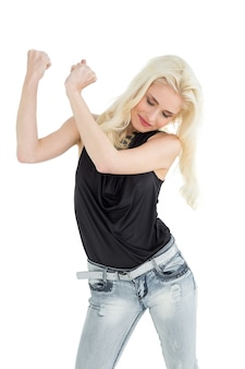 Happy young casual woman dancing