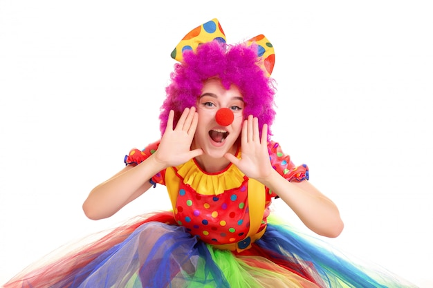Happy young clown girl on white background