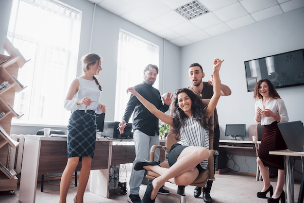Happy young colleagues smile and have fun at the creative office.