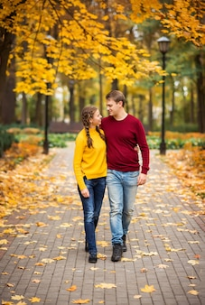 Happy young couple in the autumn park