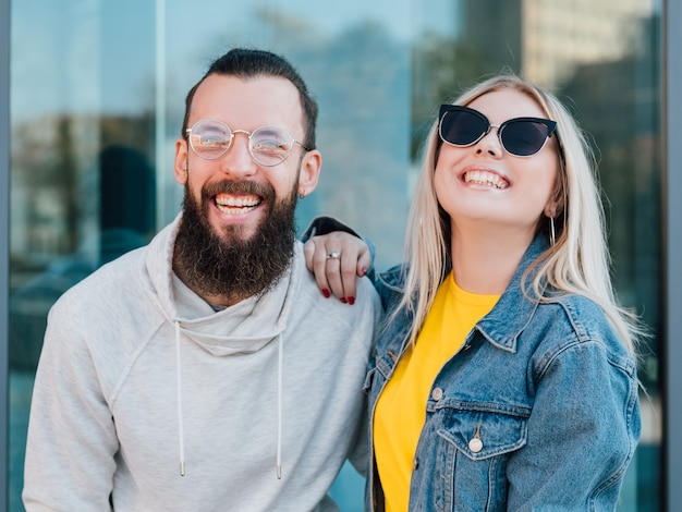 Happy young couple casual urban lifestyle smiling young man and woman