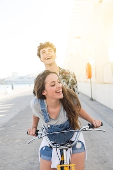 Happy young couple going for a bicycle ride