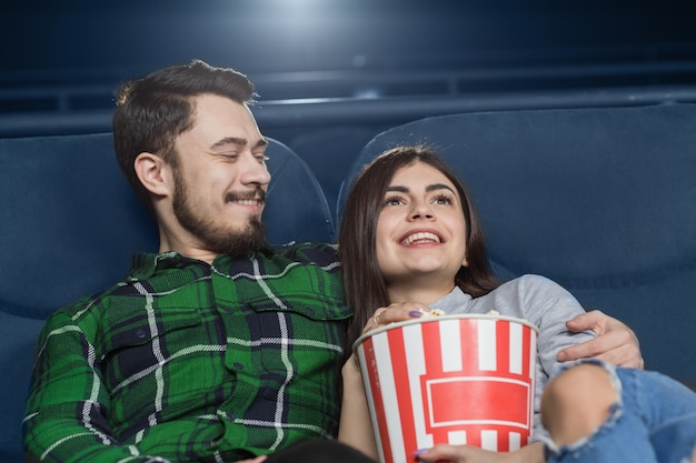Happy young couple having a date at the cinema