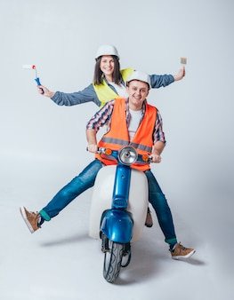 Happy young couple on motorbike. shopping for the construction and repair of a new home .
