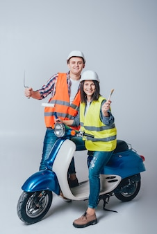 Happy young couple on motorbike. shopping for the construction