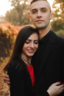 Happy young couple outdoors in the park