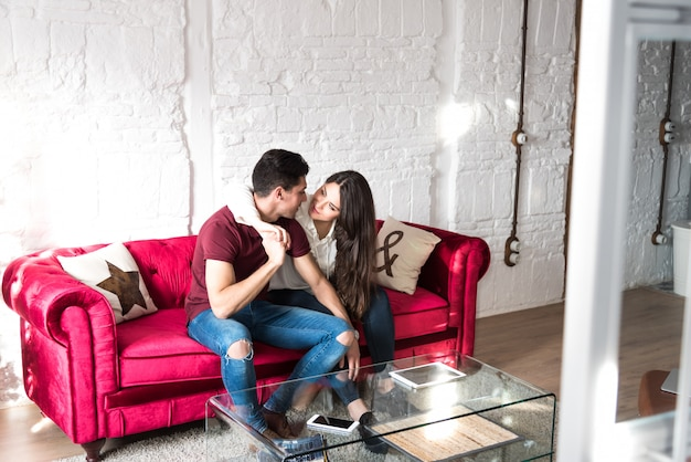 Happy young couple relaxed at home