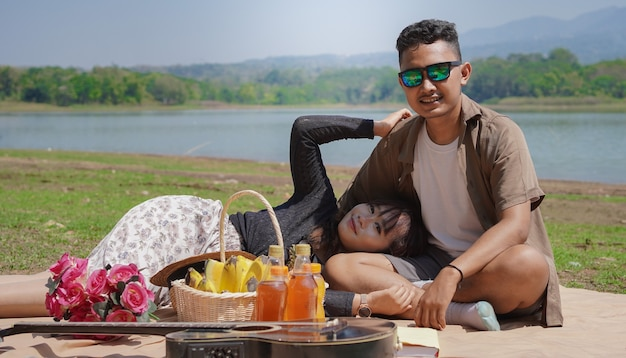 Happy young couple sleeping on lap in vacation at spring