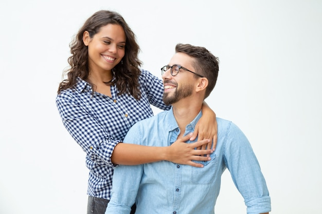 Happy young couple smiling each other