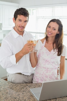 Happy young couple toasting wine glasses
