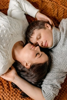 Happy young couple together in the bed. love and relationship concept