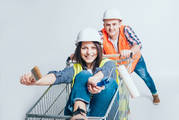 Happy young couple went shopping for the construction and repair of a new home.