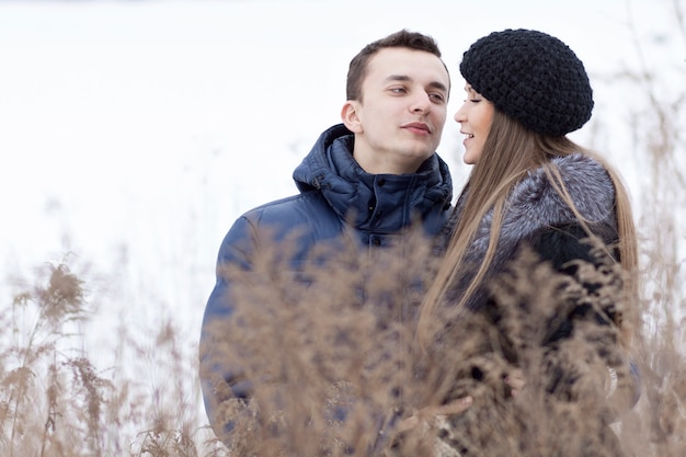 Happy young couple in winter field