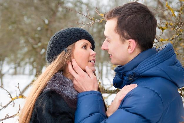 Happy young couple in winter garden