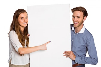 Happy young couple with blank board
