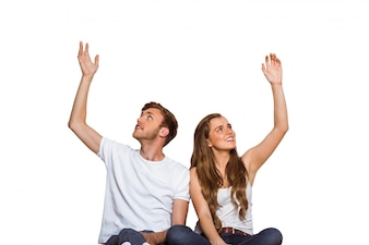 Happy young couple with hands raised
