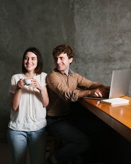 Happy young couple working on laptop