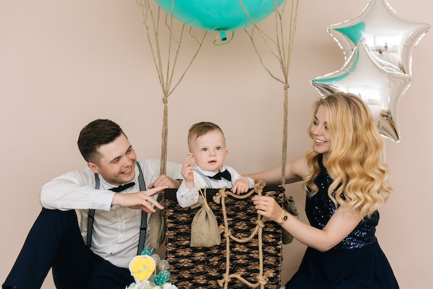 Happy young family celebrates the first birthday of the child