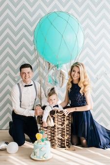 Happy young family celebrating child's birthday