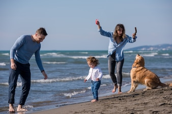 Happy young family enjoying vacation during autumn day