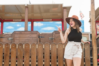 Happy young girl in the amusement park