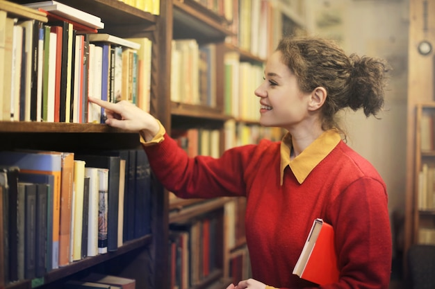 Happy young girl in the library