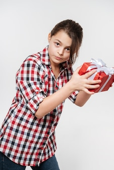 Happy young girl posing with gift